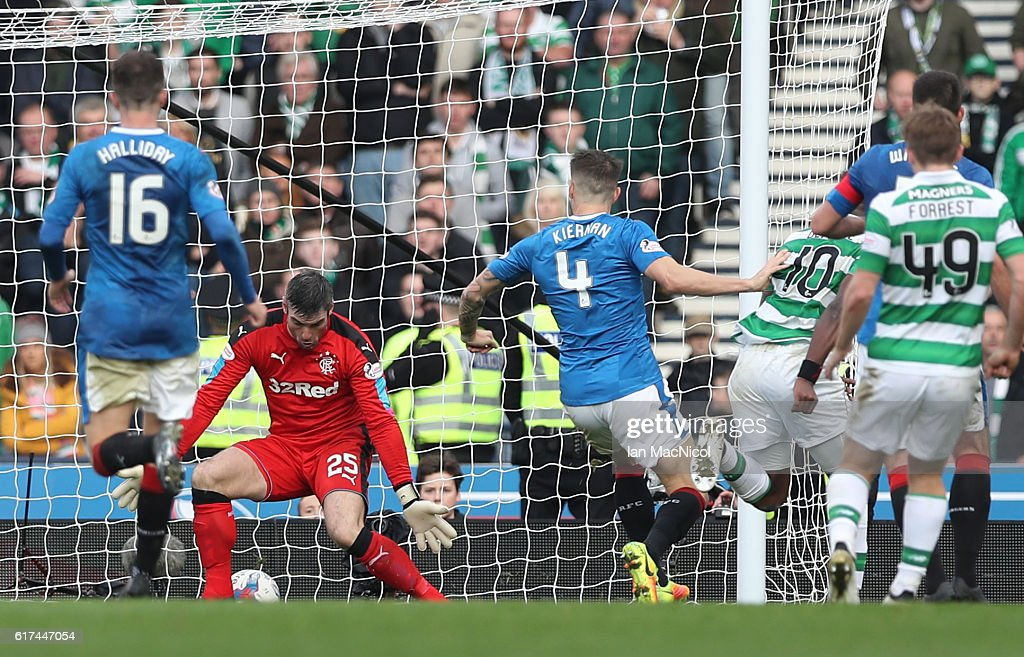 Moussa Dembele of Celtic scores through the legs of Matt Gilks of Rangers during the Betfred Cup Semi Final match between Rangers and Celtic at Hampden Park on October 23, 2016 in Glasgow, Scotland.