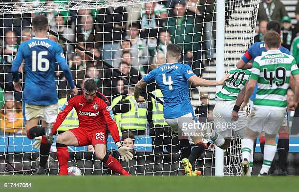 Moussa Dembele of Celtic scores through the legs of Matt Gilks of Rangers during the Betfred Cup Semi Final match between Rangers and Celtic at...
