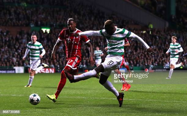 Moussa Dembele of Celtic shoots past Jerome Boateng of Bayern Muenchen and during the UEFA Champions League group B match between Celtic FC and...