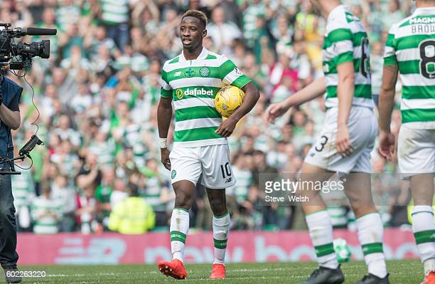 Moussa Dembele of Celtic takes away the match ball having scored 3 of the 5 goals during the Ladbrokes Scottish Premiership match between Celtic and...