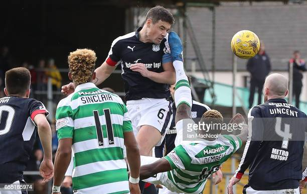 Moussa Dembele of Celtic vies with Darren O'Dea of Dundee during the Ladbrokes Scottish Premiership match between Dundee and Celtic at Dens Park...