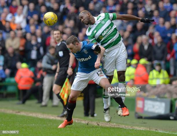 Moussa Dembele of Celtic wins a header over Lee Hodson of Rangers during the Ladbrokes Scottish Premiership match between Celtic and Rangers at...
