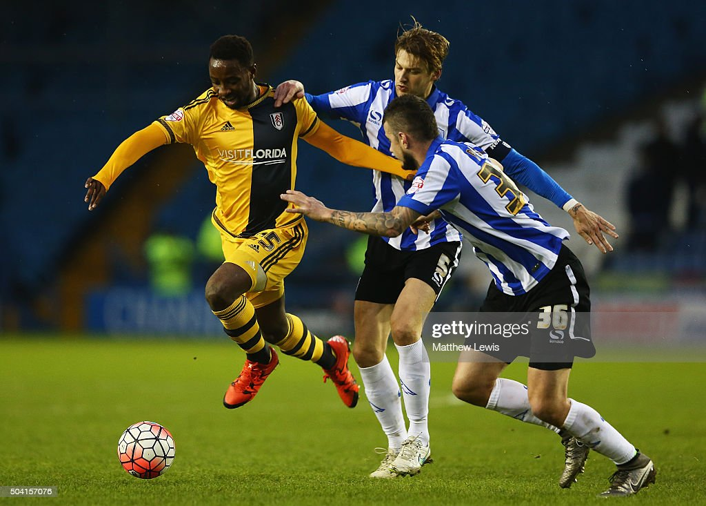 Moussa Dembele of Fulham holds the challenge from Glenn Loovens and Daniel Pudil of Sheffield Wednesday during The Emirates FA Cup Third Round match betwen Sheffield Wednesday and Fulham at Hillsborough Stadium on January 9, 2016 in Sheffield, England.