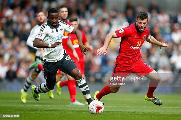 Moussa Dembele of Fulham is challenged by Grant Hanley of Blackburn Rovers during the Sky Bet Football League Championship match between Fulham and...