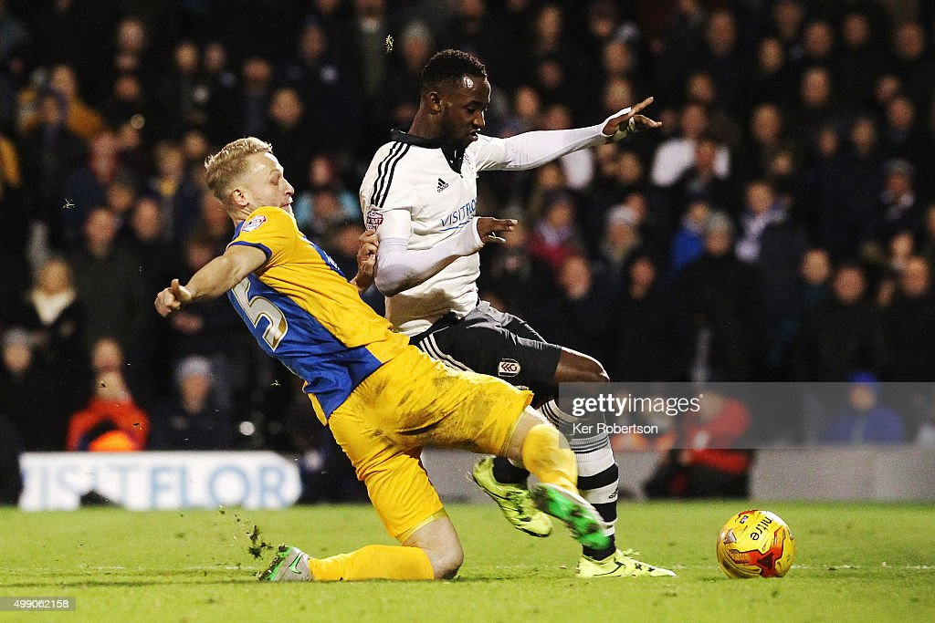 Moussa Dembele (R) of Fulham is tackled by Tom Clarke (L) of Preston North End during the Sky Bet Championship match between Fulham and Preston North End at Craven Cottage on November 28, 2015 in London, England.