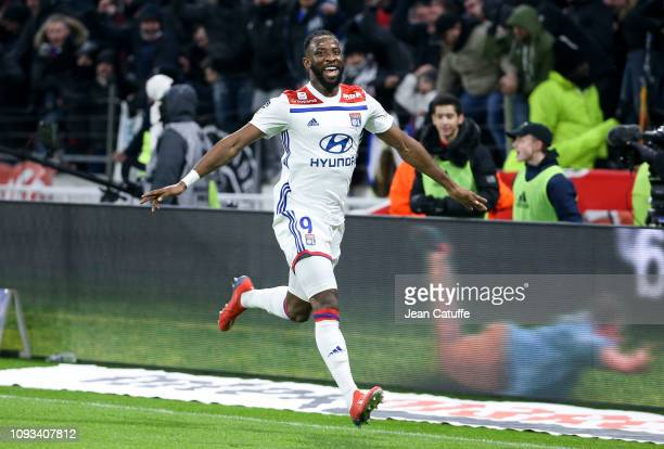 Moussa Dembele of Lyon celebrates his goal during the french Ligue 1 match between Olympique Lyonnais and Paris SaintGermain at Groupama Stadium on...