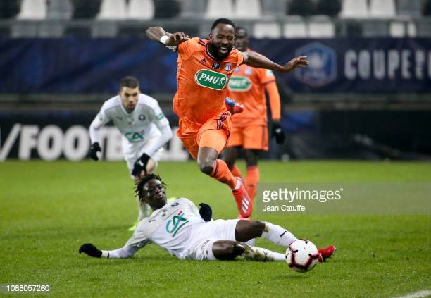 Moussa Dembele of Lyon Gaoussou Traore of Amiens during the French Cup match between Amiens SC and Olympique Lyonnais at Stade de la Licorne on...