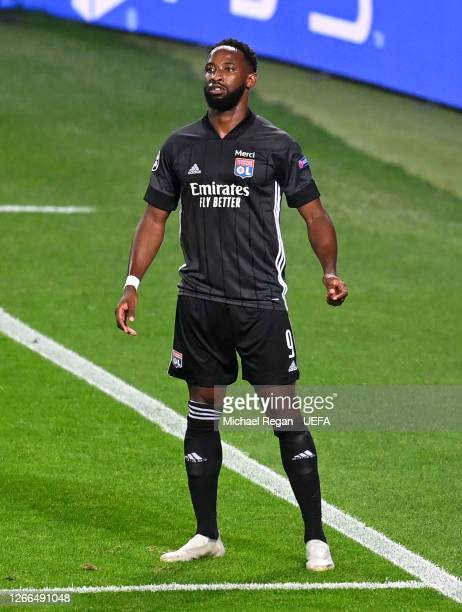 Moussa Dembele of Olympique Lyon celebrates after scoring his team's third goal during the UEFA Champions League Quarter Final match between...