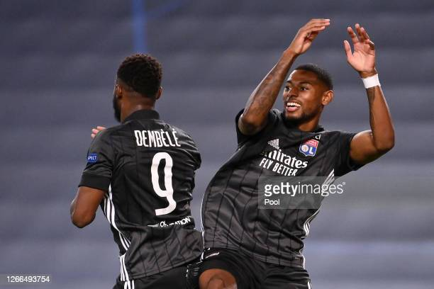 Moussa Dembele of Olympique Lyon celebrates with te after scoring his team's third goal during the UEFA Champions League Quarter Final match between...