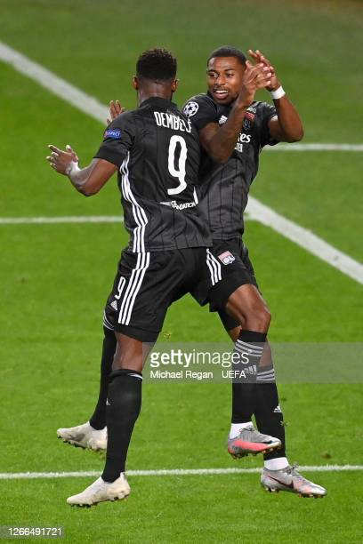 Moussa Dembele of Olympique Lyon celebrates with teammate Jeff Reine-Adelaide after scoring his team's third goal during the UEFA Champions League...