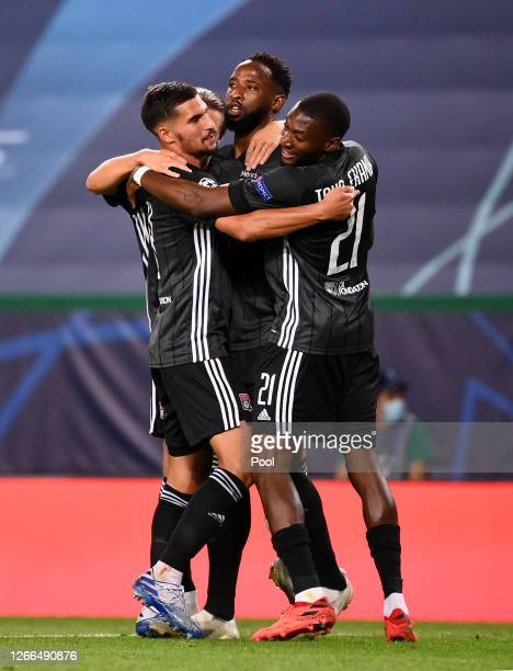 Moussa Dembele of Olympique Lyon celebrates with teammates after scoring his team's second goal during the UEFA Champions League Quarter Final match...