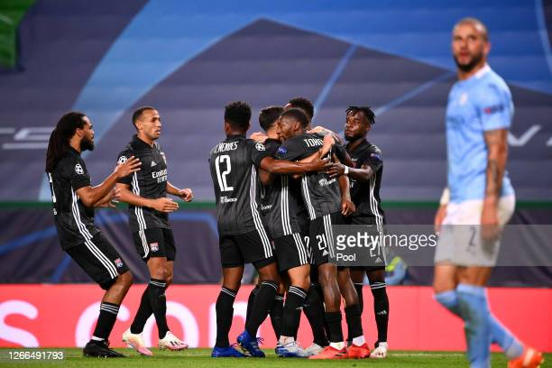 Moussa Dembele of Olympique Lyon celebrates with teammates after scoring his team's third goal during the UEFA Champions League Quarter Final match...