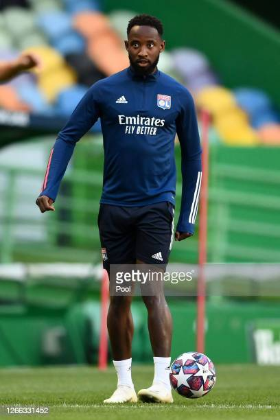 Moussa Dembele of Olympique Lyon looks on during the Olympique Lyonnais Training Session ahead of the UEFA Champions League match between Manchester...