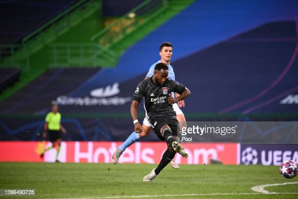 Moussa Dembele of Olympique Lyon scores his team's second goal during the UEFA Champions League Quarter Final match between Manchester City and Lyon...