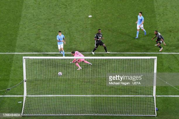 Moussa Dembele of Olympique Lyon scores his team's third goal past Ederson of Manchester City during the UEFA Champions League Quarter Final match...