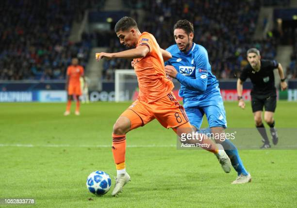 Moussa Dembele of Olympique Lyonnais holds off Florian Grillitsch of 1899 Hoffenheim during the Group F match of the UEFA Champions League between...