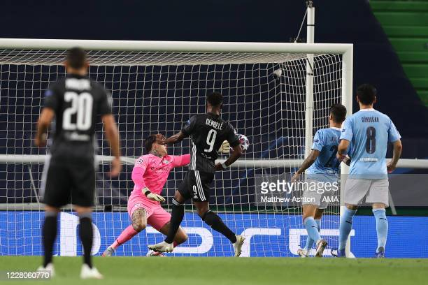 Moussa Dembele of Olympique Lyonnais scores a goal to make it 1-3 during the UEFA Champions League Quarter Final match between Manchester City and...