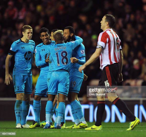 Moussa Dembele of Tottenham Hotspur celebrates with his teammates after John O'Shea of Sunderland scored an own goal during the Barclays Premier...
