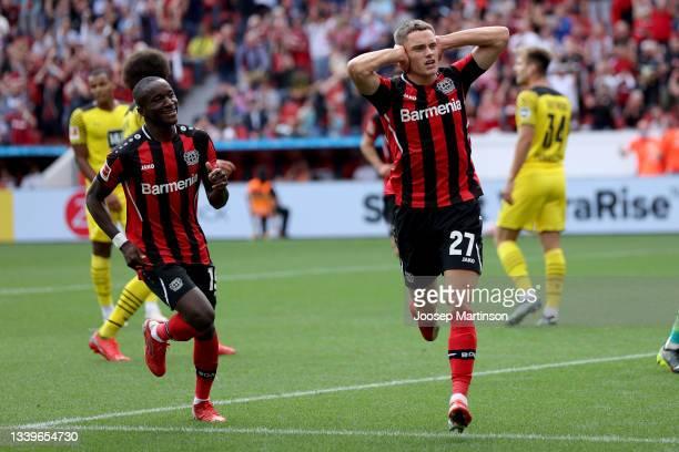 Moussa Diaby and Florian Wirtz of Leverkusen celebrate their teams first goal during the Bundesliga match between Bayer 04 Leverkusen and Borussia...