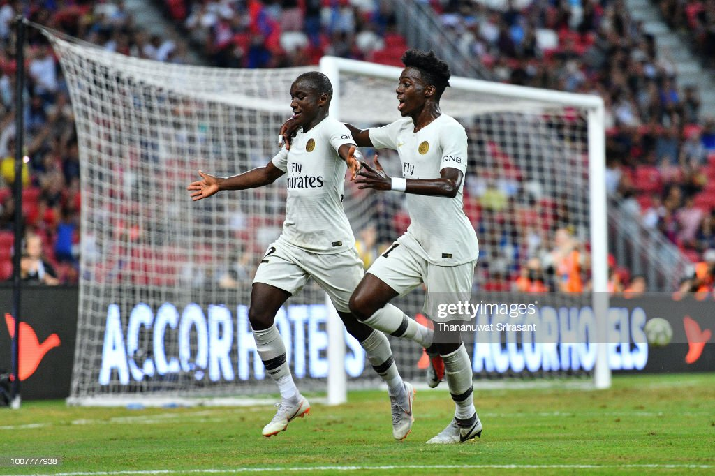 Moussa Diaby and team mate Timothy Weah of Paris Saint Germain celebrates his goal during the International Champions Cup match between Paris Saint Germain and Clu b de Atletico Madrid at the National Stadium on July 30, 2018 in Singapore.