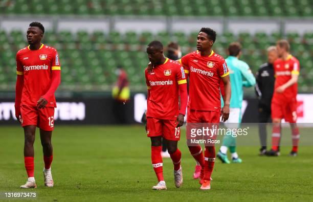Moussa Diaby and Wendell of Bayer Leverkusen look dejected following the Bundesliga match between SV Werder Bremen and Bayer 04 Leverkusen at...