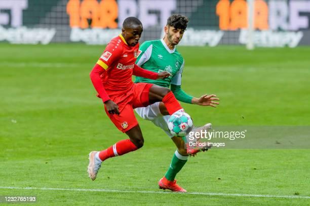 Moussa Diaby of Bayer 04 Leverkusen and Eren Dinkci of SV Werder Bremen battle for the ball during the Bundesliga match between SV Werder Bremen and...