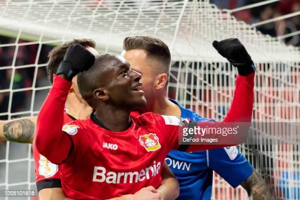 Moussa Diaby of Bayer 04 Leverkusen celebrates after scoring his team's third goal during the DFB Cup quarterfinal match between Bayer 04 Leverkusen...