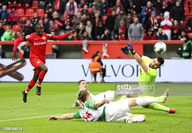 Moussa Diaby of Bayer 04 Leverkusen scores his team's first goal during the Bundesliga match between Bayer 04 Leverkusen and FC Augsburg at BayArena...