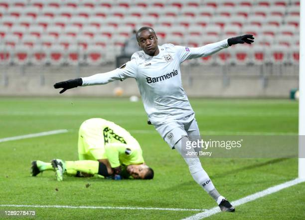 Moussa Diaby of Bayer Leverkusen celebrates his goal while goalkeeper of Nice Walter Benitez lies down during the UEFA Europa League Group C stage...