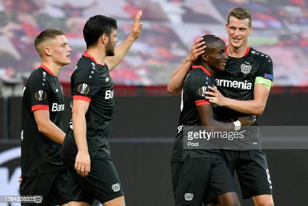 Moussa Diaby of Bayer Leverkusen celebrates with Lars Bender after scoring his sides first goal during the UEFA Europa League round of 16 second leg...