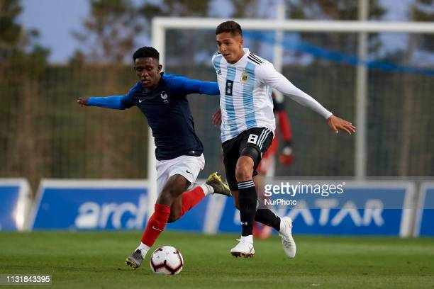 Moussa Diaby of France and Agustin Almendra of Argentina competes for the ball during the friendly match between Argentina and France U20 at Pinatar...
