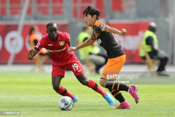 Moussa Diaby of Leverkusen defends against Kang-in Lee of Valencia during the pre-season friendly match between Bayer 04 Leverkusen and FC Valencia...