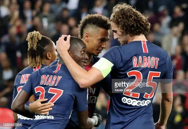 Moussa Diaby of Paris SaintGermain celebrate his goal with Adrien Rabiot and teammates goal during the French Ligue 1 match between Paris Saint...