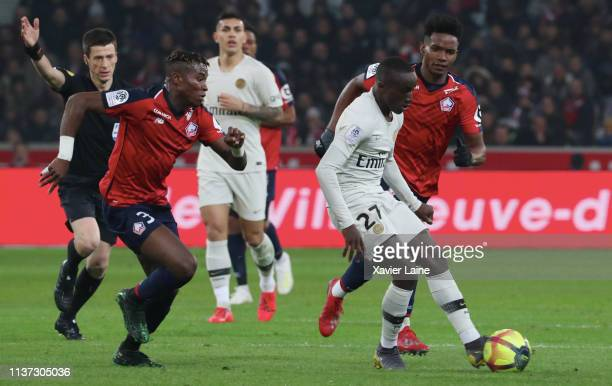 Moussa Diaby of Paris SaintGermain in action with Youssouf Kone and Thiago Mendes of Lille LOSC during the Ligue 1 match between Lille OSC and Paris...