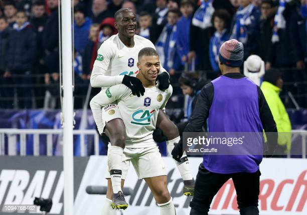 Moussa Diaby of PSG celebrates his goal with Kylian Mbappe during the French Cup match between FC Villefranche Beaujolais and Paris SaintGermain at...