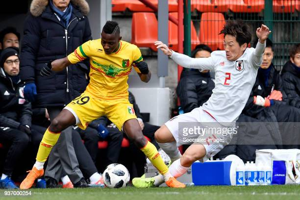 Moussa Djenepo of Mali, Tomoya Ugajin of Japan during the International Friendly match between Japan v Mali at the Stade Maurice Dufrasne on March...