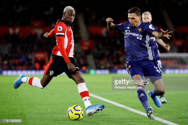 Moussa Djenepo of Southampton and Jose Holebas of Watford battle for the ball during the Premier League match between Southampton FC and Watford FC...