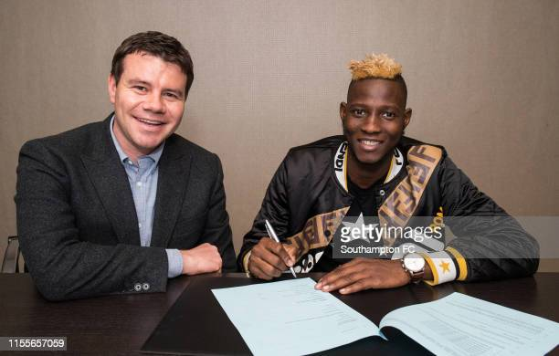 Moussa Djenepo of Southampton and Ross Wilson, Director of Football Operations at Southampton Football Club pose for a photo during the unveiling of...