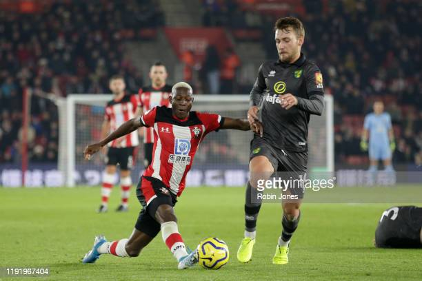 Moussa Djenepo of Southampton and Tom Trybull of Norwich City during the Premier League match between Southampton FC and Norwich City at St Mary's...