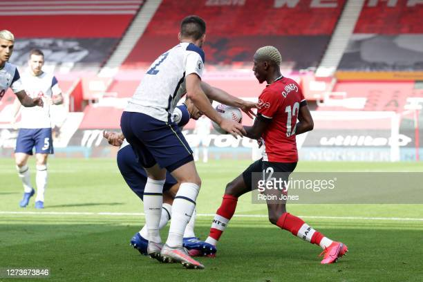 Moussa Djenepo of Southampton appeals for handball against Matt Doherty of Tottenham Hotspur during the Premier League match between Southampton and...