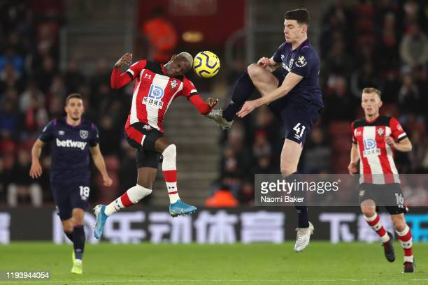 Moussa Djenepo of Southampton battles for possession with Declan Rice of West Ham United during the Premier League match between Southampton FC and...
