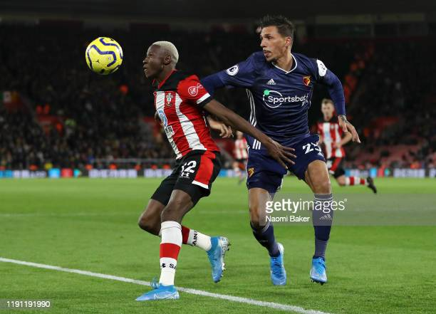 Moussa Djenepo of Southampton battles for possession with Jose Holebas of Watford during the Premier League match between Southampton FC and Watford...