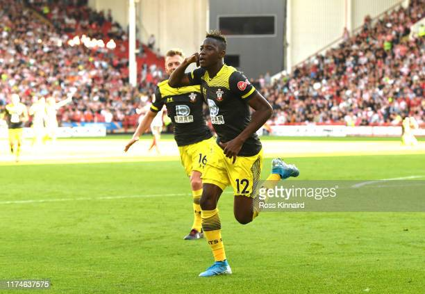 Moussa Djenepo of Southampton celebrates after scoring his team's first goal during the Premier League match between Sheffield United and Southampton...