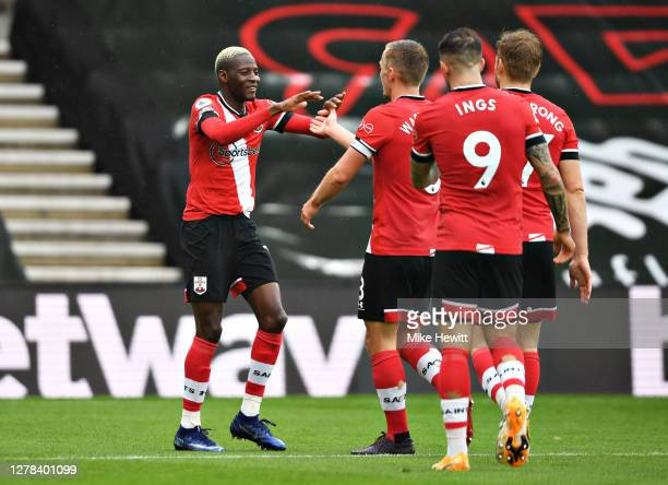 Moussa Djenepo of Southampton celebrates with teammates after scoring his sides first goal during the Premier League match between Southampton and...