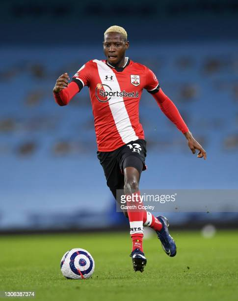 Moussa Djenepo of Southampton during the Premier League match between Manchester City and Southampton at Etihad Stadium on March 10, 2021 in...
