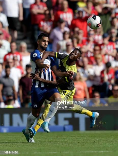 Moussa Djenepo of Southampton fouls Martin Montoya of Brighton and Hove Albion during the Premier League match between Brighton & Hove Albion and...