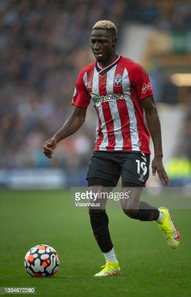 Moussa Djenepo of Southampton in action during the Premier League match between Everton and Southampton at Goodison Park on August 14, 2021 in...