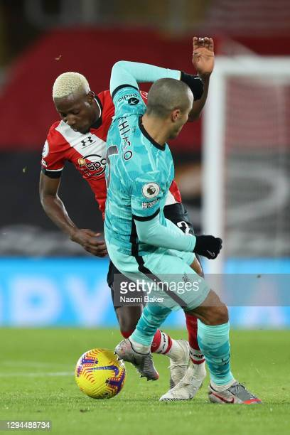 Moussa Djenepo of Southampton is tackled by Thiago Alcantara of Liverpool and is later forced off with a injury during the Premier League match...