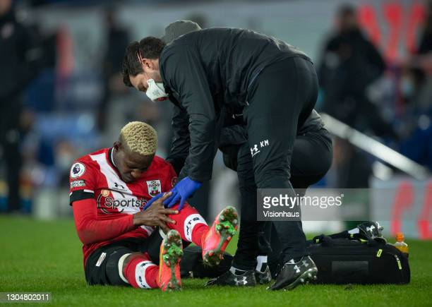 Moussa Djenepo of Southampton receives treatment before being taken off with an injury during the Premier League match between Everton and...