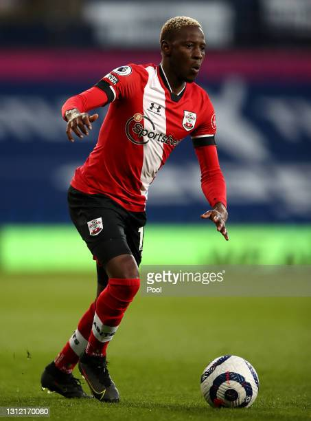 Moussa Djenepo of Southampton runs with the ball during the Premier League match between West Bromwich Albion and Southampton at The Hawthorns on...